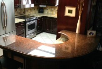 Santa Cecilia and Suede Brown Granite with Ogee Edge Profile