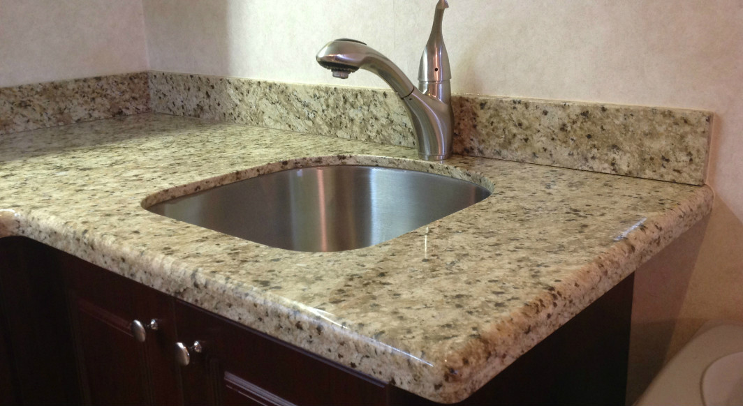 Giallo Ornamental Granite with Waterfall Edge Profile