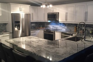 Silver Cloud Granite with Full Height Matching Backsplash