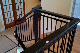 Black Pearl Custom Handrail - Bevel Edge Profile Atop Iron Banister